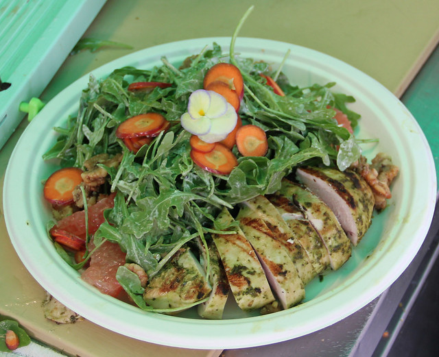 A gorgeous grilled chicken salad, made with arugula and grapefruit, garnished with dragon carrots and edible flowers from BBG's own Herb Garden. Photo by Rebecca Bullene.