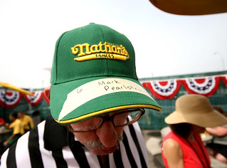 his name is on a Nathan's hat