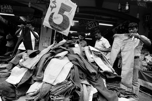 $5 jeans shopping - migrant workers congregating for great deals at Little India.