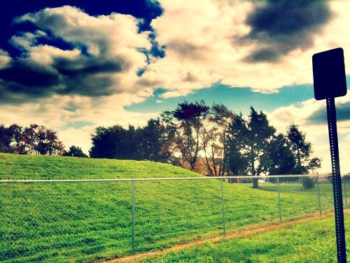 camera sky grass clouds fence iphone