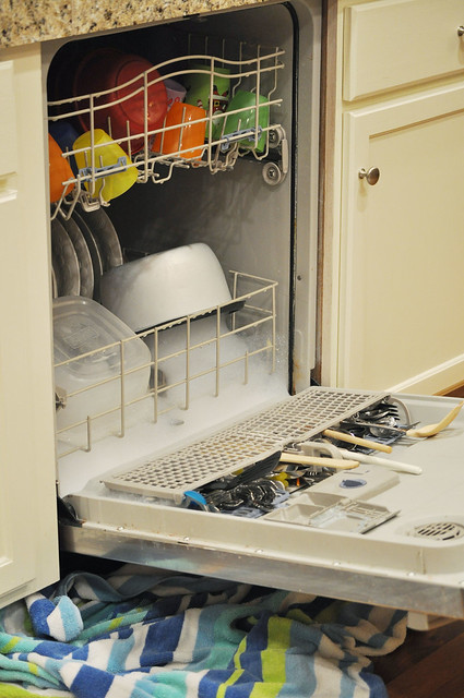 overflowing dishwasher
