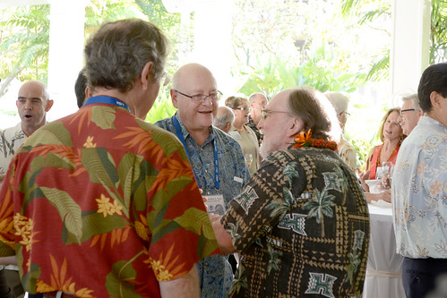 <p>Governor Abercrombie talks with UC President Mark Yudof, center, and California Institute of Technology President Jean-Lou Chameau.</p>