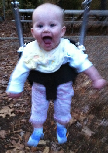 Lucy's first time in the swing.