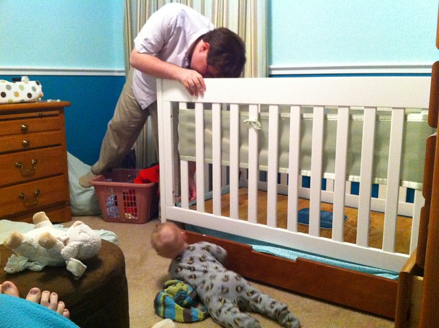 Lowering George's crib mattress.