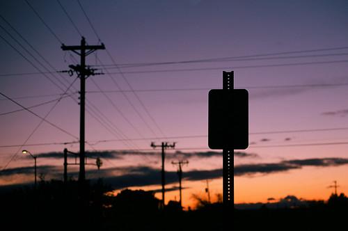 winter sunset sky newmexico film silhouette clouds 35mm 50mm streetlight streetsign albuquerque utility slide scan transparency powerline poles nm telephonepoles canonae1program utilities nightfall fujivelvia50 iso50 infrastracture