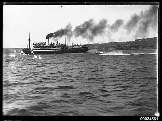 Unidentified passenger liner under steam in a harbour, 1890-1953