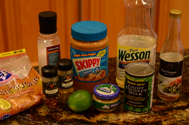 All the ingredients required to make the Thai Chicken Salad dressing arranged on a counter top.