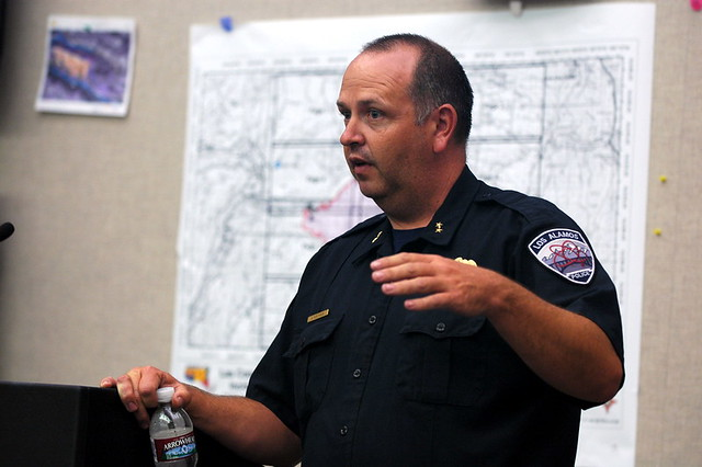 Deputy Chief Kevin Purtymun of Los Alamos Police Department at the podium of the Laboratory's Emergency Operations Center.