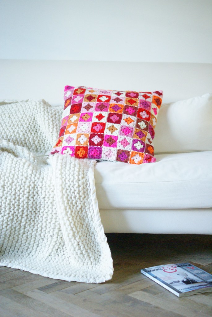 brightly colored pillow by wood & wool stool