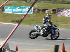 superbike racing(0.0), freestyle motocross(0.0), dirt track racing(0.0), stunt performer(0.0), motocross(0.0), racing(1.0), vehicle(1.0), sports(1.0), race(1.0), motorcycle(1.0), motorsport(1.0), motorcycle racing(1.0), road racing(1.0), extreme sport(1.0), motorcycling(1.0), supermoto(1.0), stunt(1.0),