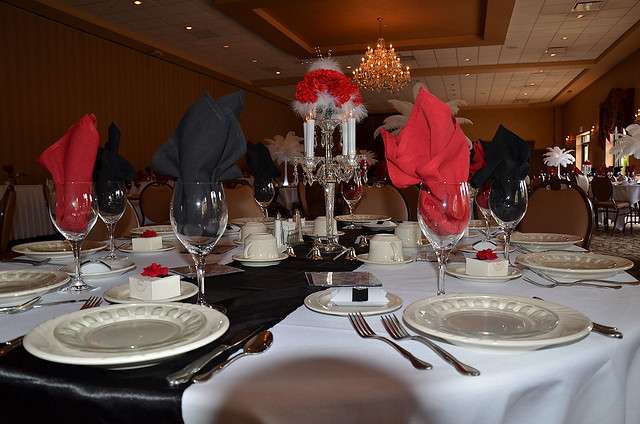 Accenting the red white and black wedding decor the wedding reception