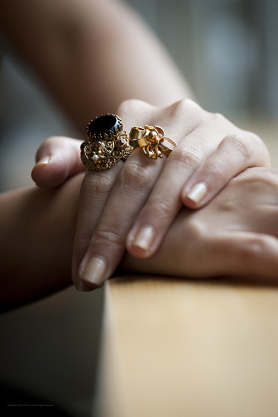 From left, 1950s West Germany gold-toned ring with a tortoiseshell-like stone; 1960s gold-toned ribbon-effect ring.