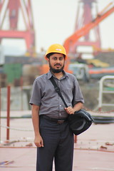 EJ wearing yellow safety helmet At new Xingang Shipyar, Tianjin by Engineer J