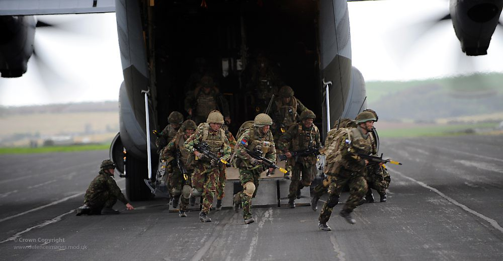 Paratroopers from 3 Para Exit a C130 Hercules Aircraft During Exercise Joint Warrior in Scotland