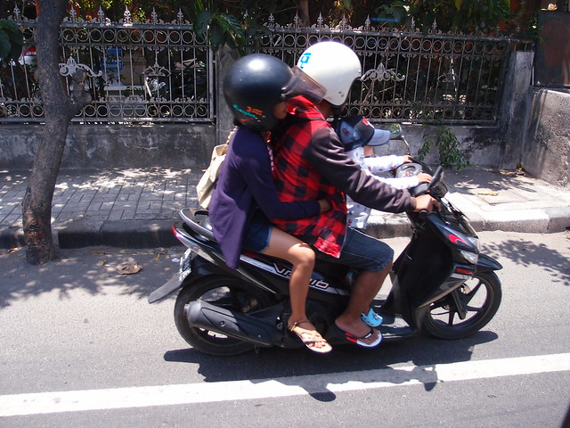 People travelling on Scooters & Motorbikes - Bali Indonesia