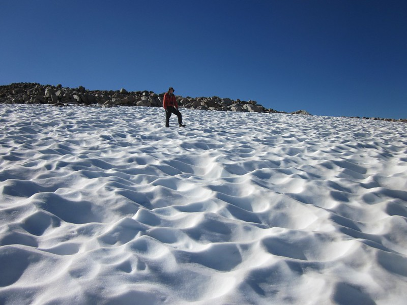 Sun-cupped snowfield in Dusy Basin near Bishop Pass and Peak 12118