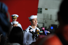 HONG KONG  (Nov. 9, 2011) USS George Washington Sailor, Seaman Morris Ng, a native of Hong Kong, introduces himself to 47 Chinese journalists during a news conference held in the aircraft carrier's hangar bay following the ship's arrival in Hong Kong for a port visit. (U.S. Navy Photo by Mass Communication Specialist Seaman Alysia R. Hernandez)