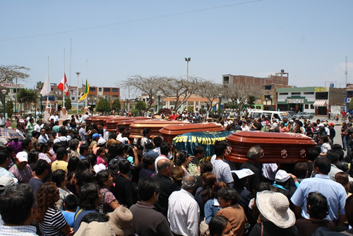 Relatives carry El Santa victims around the town plaza
