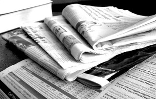 Newspapers in black and white. Image from NS Newsflash on Flickr
