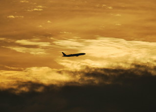 Sunset departure of KLM Boeing 777 from Schiphol