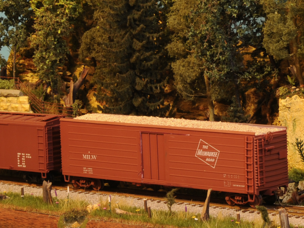 What freight cars carry wood chips and sawdust, respectively