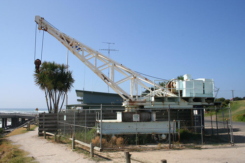 Stored on dry land, the old crane from the Lorne Pier awaiting a new life