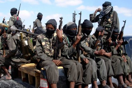 A column of Al-Shabaab fighters in Somalia. The organization reported that it ambushed and killed 30 Kenyan troops involved in a US-backed invasion of the Horn of Africa state. by Pan-African News Wire File Photos