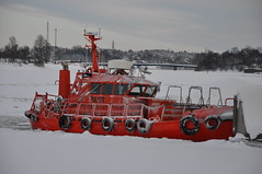 snowplow(0.0), tugboat(0.0), winter(1.0), vehicle(1.0), snow(1.0), ice(1.0), icebreaker(1.0), watercraft(1.0), boat(1.0),