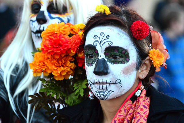 Paitned faced woman day of the dead Mexico