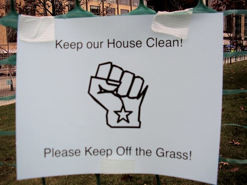 Sign on the green fence at the Capitol