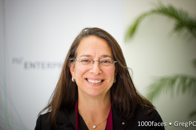 Face - smiling woman with long hair and glasses