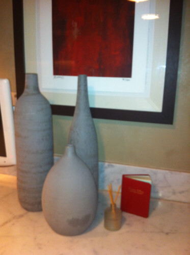 cjinteriors posted a photo:	This set of gray pots looks great with the carrera marble countertops.  The red accentuates the gray and adds a pop of color.