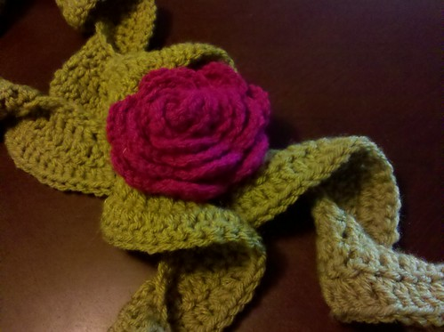 Crochet flower pin on twirly scarf