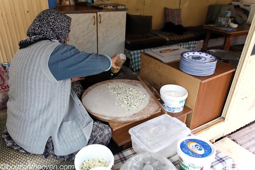 Woman making gözleme - Turkish crepes