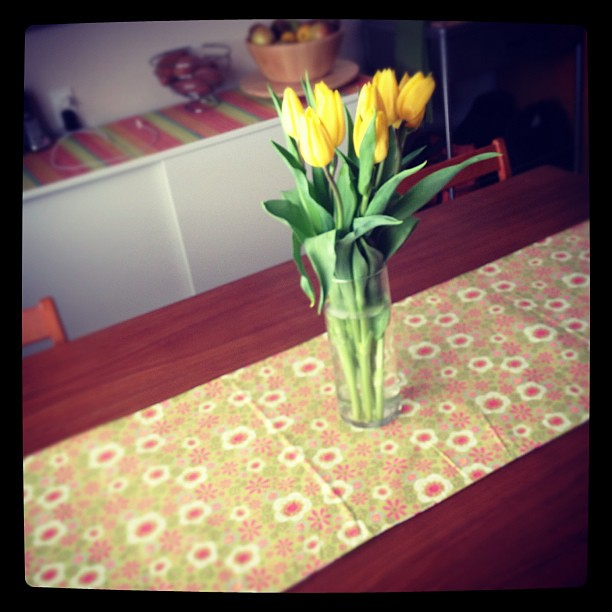 It's ridiculous how happy a change of table runner & a cheap bouquet can make me.