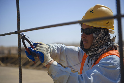 Construction worker places rebar