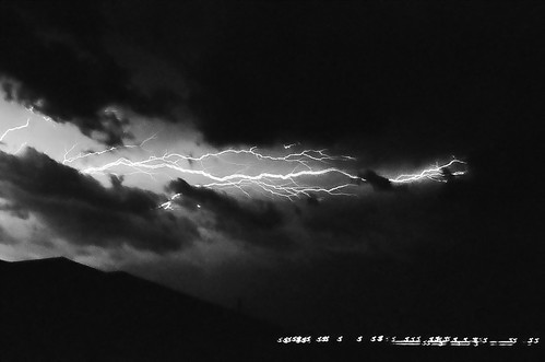 camera sky blackandwhite storm film nature weather night clouds 35mm vintage landscape glow texas different ominous sears josh lightning tracker thunder denton chaser strangely spotter sanger ksx