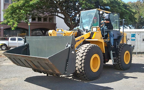 <p>There were 13 heavy equipment sponsors who brought their machines and operators. Pictured is a front-end loader.</p>