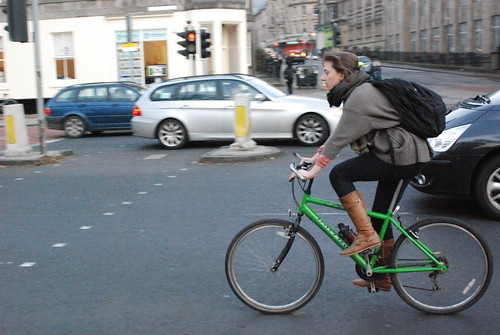 Tan boots, green bike