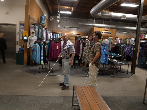 Me walking in the store with Daniel with cane