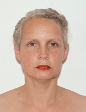 white woman staring at the camera with red lips