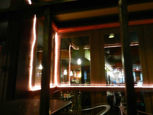 Ghost face, window reflection and lights, The Ave, U District, Seattle, Washington, USA by Wonderlane