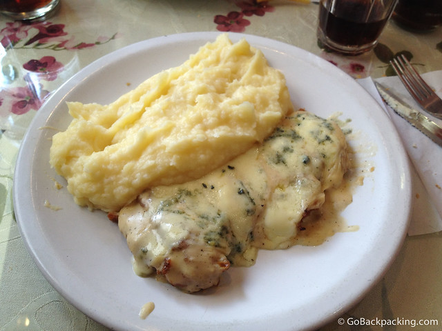 Blue-cheese smothered meat and mashed potatoes