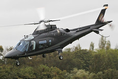 G-ZIPE - 2011 build Agusta A109E, departing a grey, damp Barton