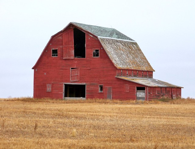sk11j03 red hip roof barn in rm harris saskatchewan