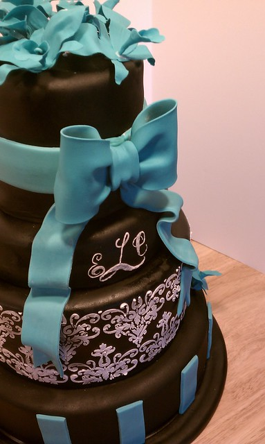 Black white and teal wedding cake