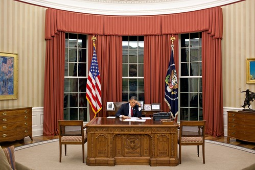 President Barack Obama edits his remarks in the Oval Office