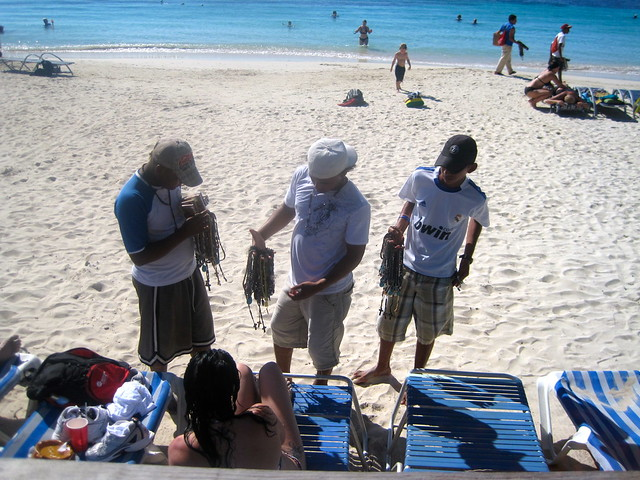 beach vendors hoarding the beachgoers roatan honduras