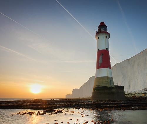 sunset sea england lighthouse beach sussex coast aircraft cliffs contrails eastsussex beachyhead trinityhouse beachyheadlighthouse