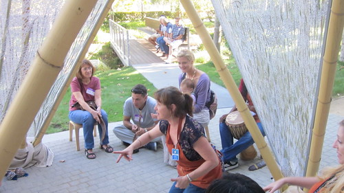 Families enjoy storytime in the Skirball's sukkah